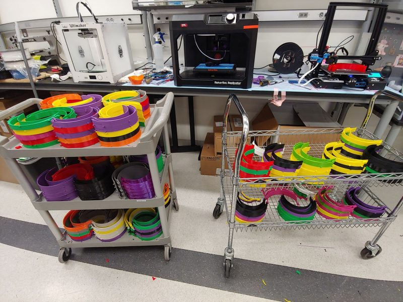 Lab space and resources in biomedical engineering and mechanics are being used to 3D print face shield headpieces, as pictured here in a variety of colors.