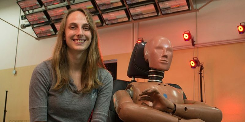 A photo of Biomedical engineering and mechanics graduate student Devon Albert with a crash test dummy