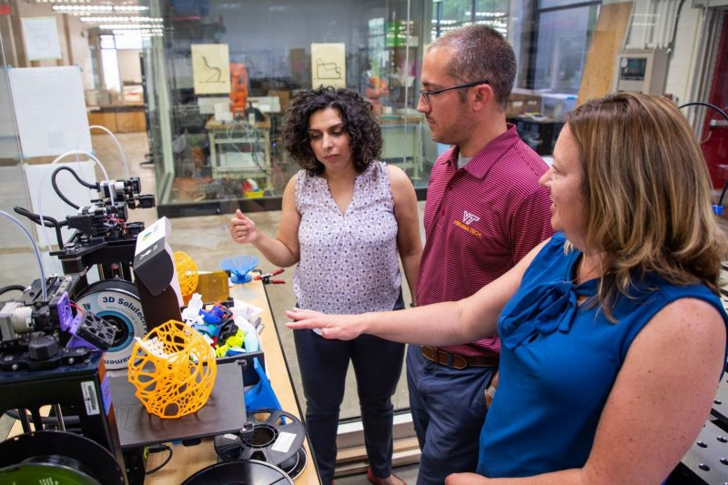Elham Morshedzadeh, Chris Arena, and Pamela VandeVord (left to right) discuss possible fabrication methods for biomedical device prototypes, including 3D printing. Throughout the new course, students will design a device, application, or system to address an unmet health care need of wounded veterans.