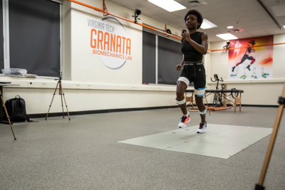 Student running with sensory measures on limbs, in Granata Lab