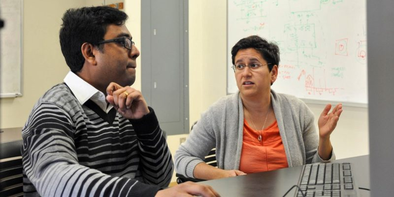 A photo of Subhradeep Roy (left) and Nicole Abaid in the Complex Systems Laboratory at Virginia Tech.